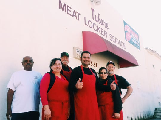 Daniel Mendes, owner of Tulare Meat Locker Service, stands with his staff outside of his business. Mendes walked away with with 11 awards from C.A.M.P (The California Association of Meat Processors) which has been in service for over 60 years in order to improve performance and enhance business practices for fellow meat processing companies.