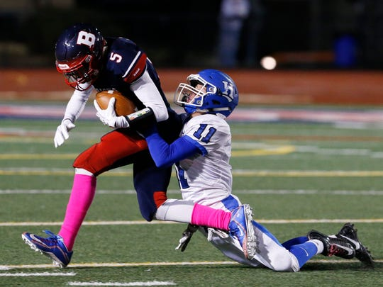 Binghamton's Jaylin Ragsdale is taken down by Horseheads' Matthew Stasiw during Friday's game at Binghamton on October 27, 2017.