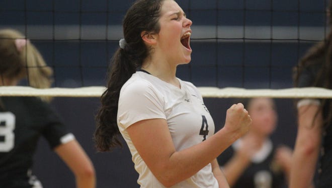 Sneads junior outside hitter Lacee Glover celebrates a point during a senior-night volleyball game on Tuesday.