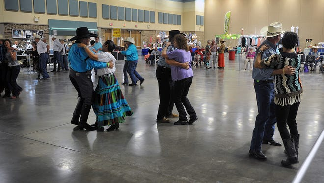 Dancers scoot around the dance floor Thursday afternoon during the opening set of the three-day Legends of Western Swing music festival at the Ray Clymer Exhibit Hall.