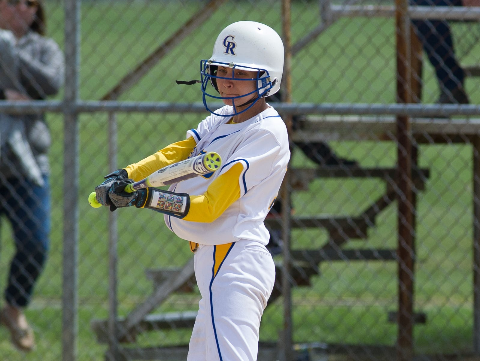 Caesar Rodney's Courtney Malin (15) with a hit in the 5th inning to advance a runner home in their game against Concord.