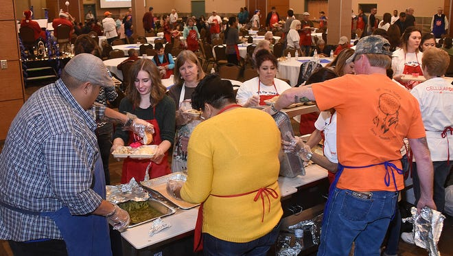 Salvation Army volunteers serve Thanksgiving Day meals to the public last year at the Farmington Civic Center.