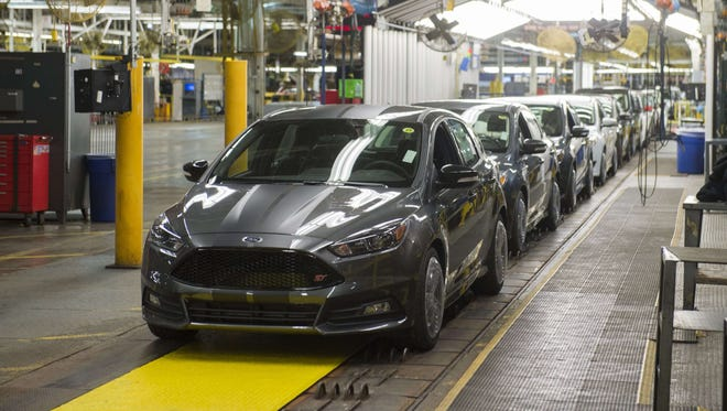 This January 7, 2015 file photo shows a lineup of Ford Focus at the company's Michigan Assembly Plant in Wayne, MI.