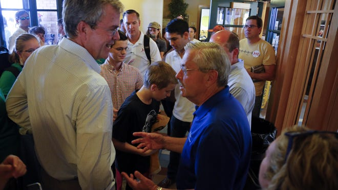 Republican presidential candidate, former Florida Gov. Jeb Bush, talks with Iowa Gov. Terry Branstad at the Iowa State Fair on Aug. 14.
