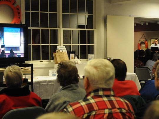 About 150 people filled two rooms (with video feed) for the Door County Maritime Museum's speaker series featuring Paul Gray (at right through door way), who is program and operations director for Palmer Johnson Yachts, Sturgeon Bay.