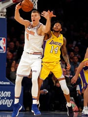 Dec 12, 2017; New York, NY, USA; New York Knicks forward Kristaps Porzingis (6) and Los Angeles Lakers forward Brandon Ingram (14) battle for a loose ball during the first half at Madison Square Garden.