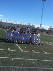 The Fort Collins High School soccer team goes through