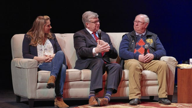 Appleton Mayor Tim Hanna, center, talks earlier this month with the former mayor the Canadian town of Appleton, Derm Flynn, right, and actress Julie Reiber at the Fox Cities Performing Arts Center.