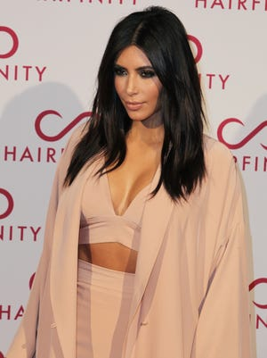 Kim Kardashian at the Hairfinity party in central London on Nov. 8, 2014.