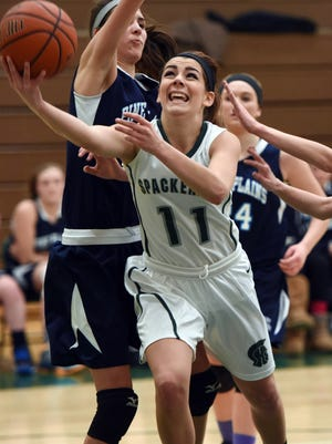 Spackenkill's Nina Hartenfels goes to the basket as Pine Plains' Ashley Starzyk, left, defends. Spackenkill faces Irvington in the state playoffs Wednesday.