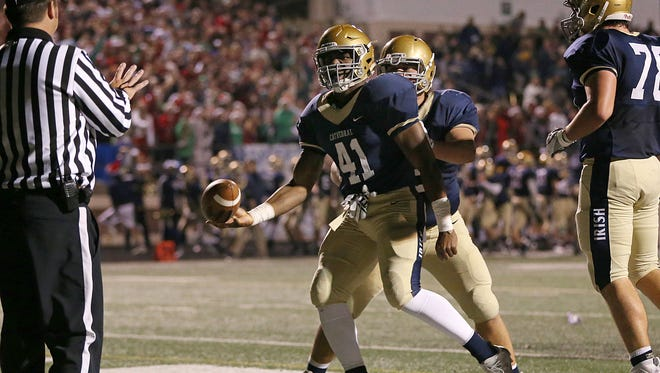 Cathedral Fighting Irish running back Markese Stepp (41) scores a touchdown during second half action of sectional finals at Arsenal Technical High School, Friday, November 4, 2016. Cathedral won in overtime, 20-17.