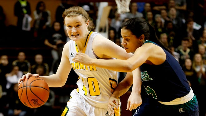 Grosse Pointe North's Julia Ayrault drives towards the key as she is defended by Saginaw Heritage's Moira Joiner during of Heritage's 46-28 win in the Class A state semifinal at Calvin College's Van Noord Arena in Grand Rapids on Friday, March 16, 2018.