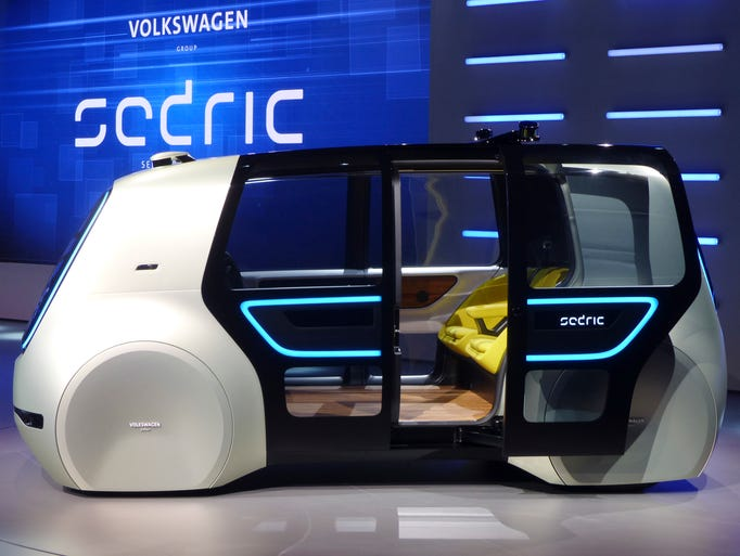 A Sedric concept car is displayed during a Volkswagen