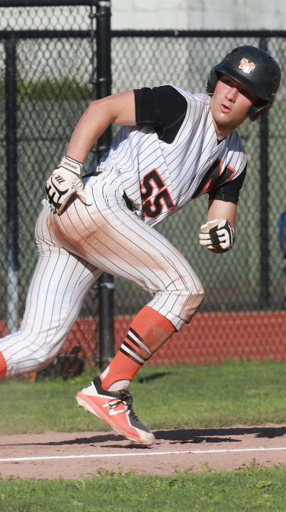 Mamaroneck's Max Bohn (55) keeps the eye on the pitcher