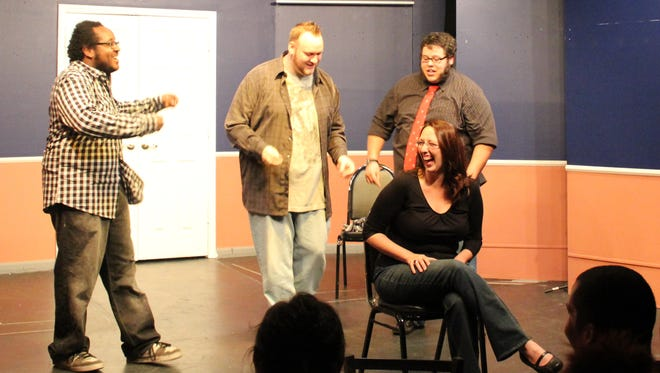 Rocky Williams, Stefan Gearhart and, members of the improv group Damaged Goods, with a guest. The  troupe performs the day after Christmas at The Bard's Town.