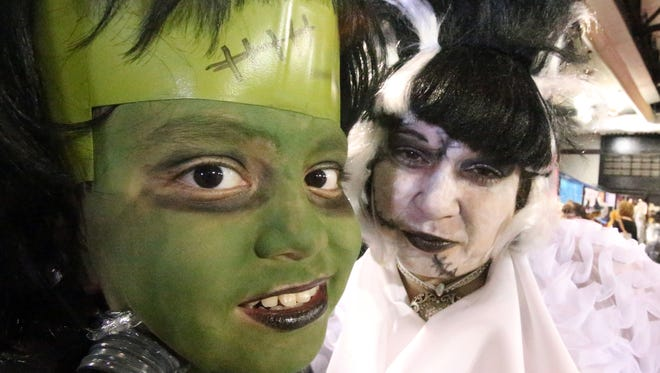 Cristian Daly, left, and his mother, Christina Daly, dress the part at the 26th annual Spooktacular Halloween carnival at the El Paso County Coliseum.