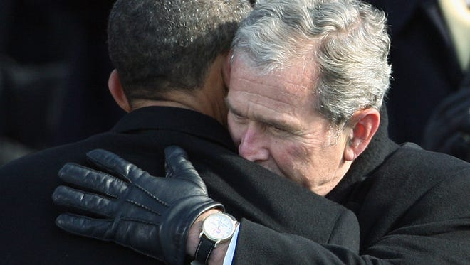 Former President George W. Bush hugs newly sworn President Barack Obama at the U.S. Capitol on Jan. 20, 2009.