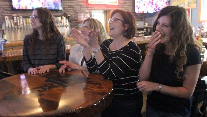 "Christine Brandenburg, right, Wausau, reacts as she watches herself on ""Let's Make A Deal"" at BB Jack's in Wausau, Thursday, April 16, 2015. The show was taped in November of 2014. Brandenburg is watching with, from left, sisters Nicole Kraft, Merrill, and Jennifer Mogenson, Hatley, and mom, Jean Mogenson, Mosinee."