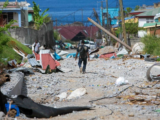 Homes and businesses along the streets of Roseau, Dominica continue to clean up and rebuild from the destruction caused by Hurricane Maria.