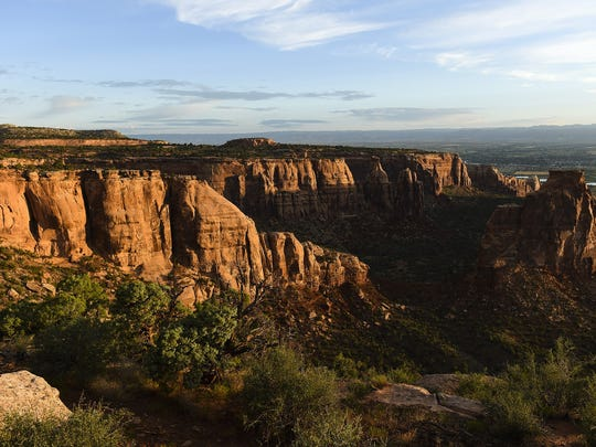 The sun rises over Colorado National Monument Wednesday, July 15, 2015, near Grand Junction, CO.
