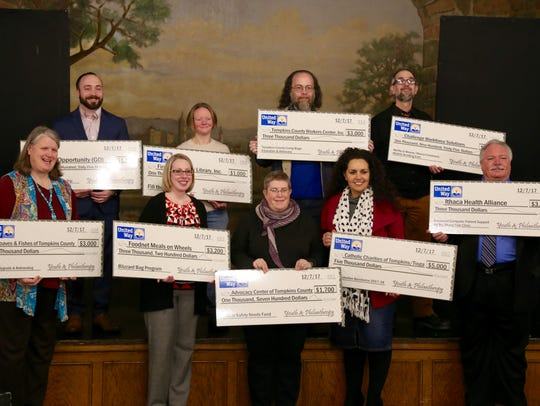 Representatives from 10 local nonprofits accepted $25,000