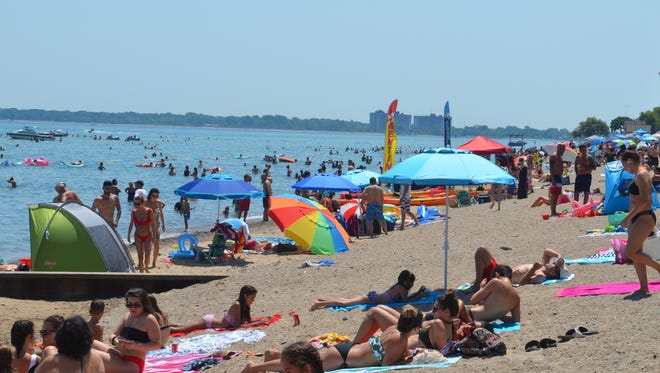 Visitors packed Lakeside Beach to enjoy the summer sun on July 4, 2018, in Port Huron, Michigan.