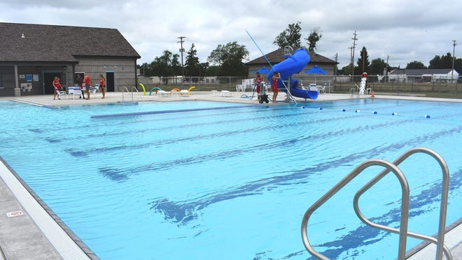 Blissfield's new aquatic center will host a grand-opening celebration at noon Saturday, July 25. A ribbon-cutting ceremony will be from noon to 12:30 p.m., with open swimming taking place throughout the afternoon. Lifeguards and staff prepared for guests Wednesday morning by cleaning the pool area.