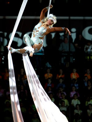 An aerialist performs at the circus at JQH Arena in 2013.