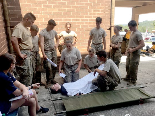 Fairview High School JROTC cadets evaluate injuries during the First Aid event at the State competition.