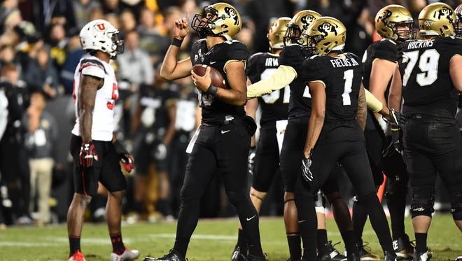 Colorado quarterback Sefo Liufau and teammates celebrate after beating Utah to clinch their spot in the Pac-12 title game.