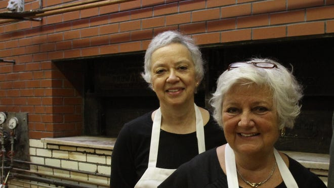 Carol Gaeta,  left, shown here with her late sister Lois Ellis, will not reopen Scialo Bros. Bakery on Federal Hill. Here they showed off their newly rebuilt oven in 2011.