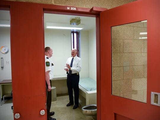 Stearns County Sheriff Don Gudmundson talks with jail administrator Mark Maslonkowski Wednesday, June 14, at the Stearns County Jail in St. Cloud.