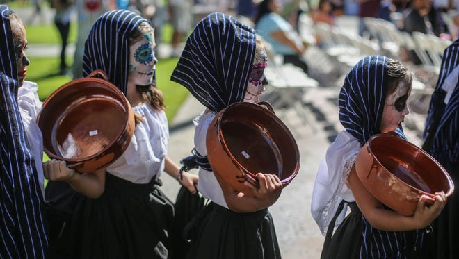 Students from the Son De Mexico dance school perform during the Dia de los Muertos celebration at Desert Memorial Park in Cathedral City on Saturday, October 28, 2017.