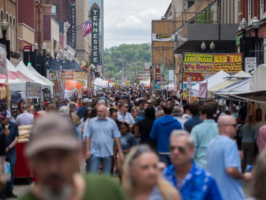 Attendees walk on Gay Street at the 17th Rossini Festival