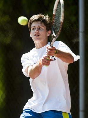 South Burlington sophomore Trent Newman hits the ball during the Vermont high school boys tennis championship last month.