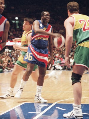 In this 1993 photo, the Harlem Globetrotters' Meadowlark Lemon prepares to put the moves on Washington Generals' Tim Burkhart during a basketball game at Madison Square Garden.