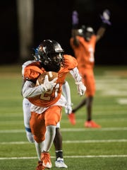 Lely's Luc Thelice carries the ball into the end zone