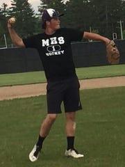 Mosinee third baseman Zach Bednar makes a throw to first during a team practice last week.
