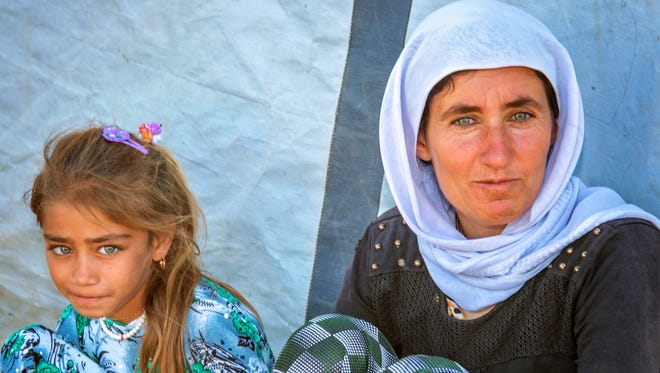 Two faces of people in Northern Iraq.