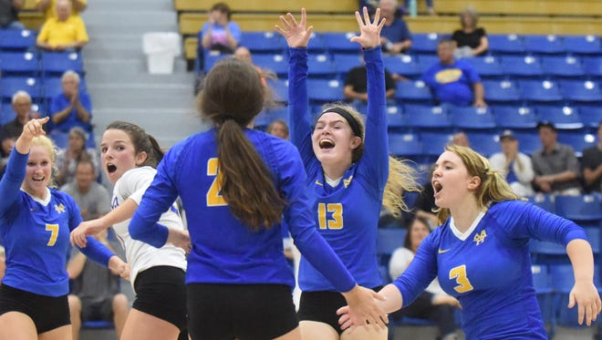 Mountain Home players celebrate a point during the Lady Bombers' win over Greene County Tech on Thursday night at The Hangar.