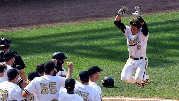 Vanderbilt's Rhett Wiseman (8) jumps into the air...