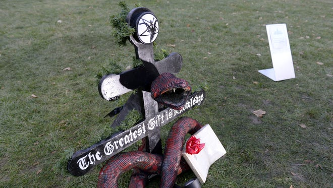 LSJ File photo A Snaketivity scene was put up last year by the Satanic Temple of Detroit on the grounds of the Capitol in downtown Lansing. The group plans to re-erect it this month.