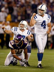 Adam Vinatieri and Hunter Smith celebrate the game winning fieldgoal as time expired against the Vikings'  Tyrell Johnson. The Indianapolis Colts traveled to Minnesota to take on the Vikings Sunday afternoon, September 14, 2008. The Colts won the game 18-15.