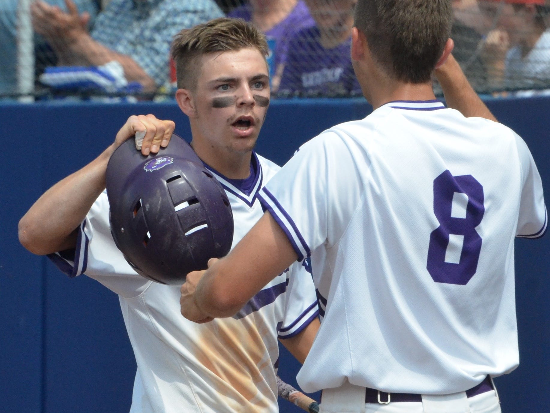 Christ Presbyterian Academy junior Seth Townsend is greeted by teammate Devin McKnight after scoring the game-tying run during the second inning of Friday's TSSAA Class AA state baseball championship game at MTSU's Reese Smith Jr. Field.