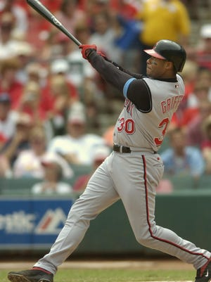 Ken Griffey Jr. hits his 500th career home run off St. Louis Cardinals pitcher Matt Morris at Busch Stadium in St. Louis on June 20, 2004.