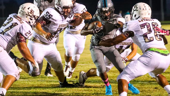 ELCHSÕs Marcus Squires gains yards for the Jaguars and goes on to score against Riverdale. Riverdale at East Lee Football Monday, October 2nd, 2017.