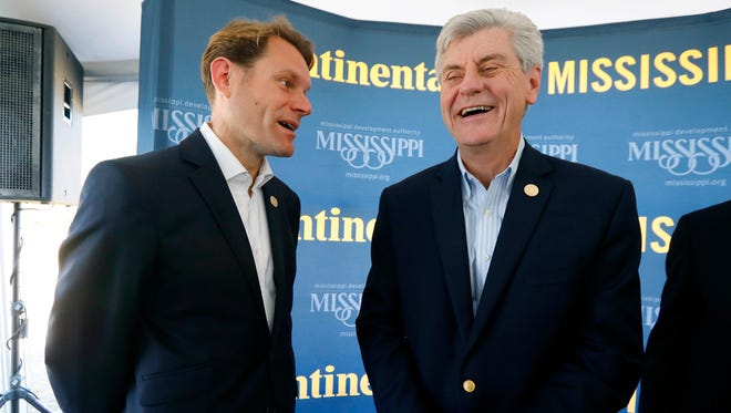 Nikolai Setzer, a member of Continental AG's executive board and head of Continental's global tire business worldwide, left, jokes with Mississippi Gov. Phil Bryant, prior to the ceremonial start on construction of the German company's $1.45 billion tire plant in Clinton, Miss., Thursday, Nov. 3, 2016. The plant is supposed to open in 2019 and ultimately grow to employ 2,500 workers.