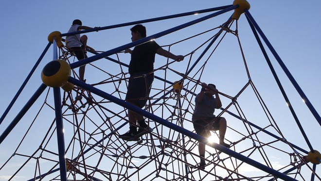 Children play on the playground at Wilson Elementary School in Phoenix. Arizona finished 46th out of the 50 states in a survey that looked at factors rangingfrom the percentage of kids living in poverty, to the teen birthrate to access to health care.