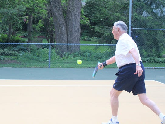 Bill Van Riper, chases the ball, during an evening