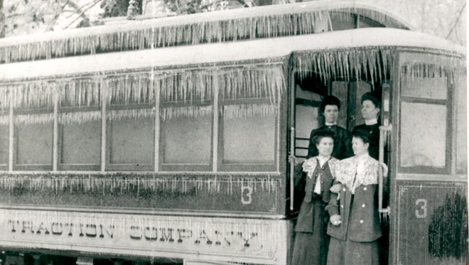 A group of women stand on an Anderson streetcar during a 1905 winter storm.